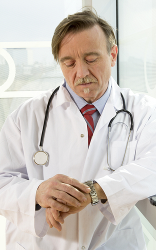 Doctor looking at watch
