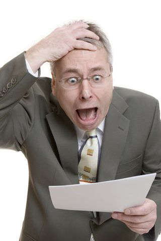 Shocked man with paperwork