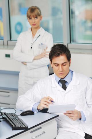 Medical people at computer