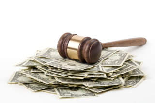 Gavel with cash